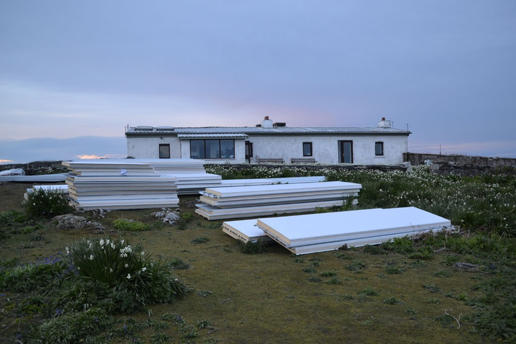 Roof panels sitting outside Observatory building on Saturday evening