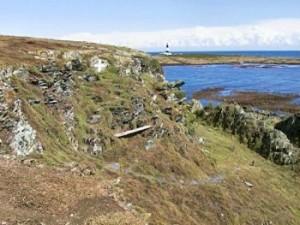 Seat under cliff on Copeland Bird Observatory